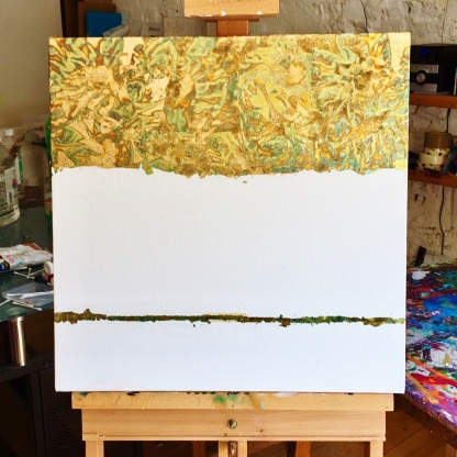 the beginning of a variegated gold leaf and turquoise painting